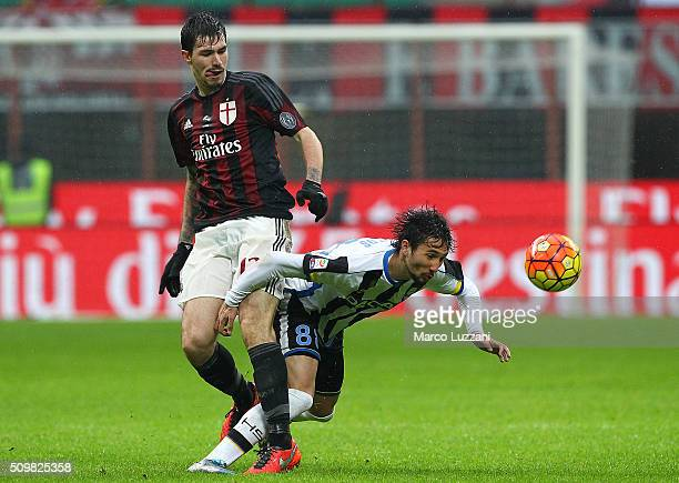 Ryder Matos Santos of Udinese Calcio competes for the ball with Alessio Romagnoli of AC Milan during the Serie A match between AC Milan and Udinese...