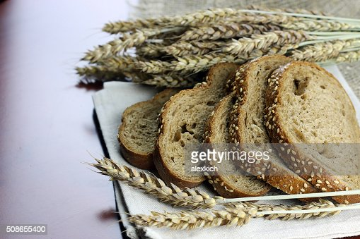 rye bread and ears on the table : Stock Photo