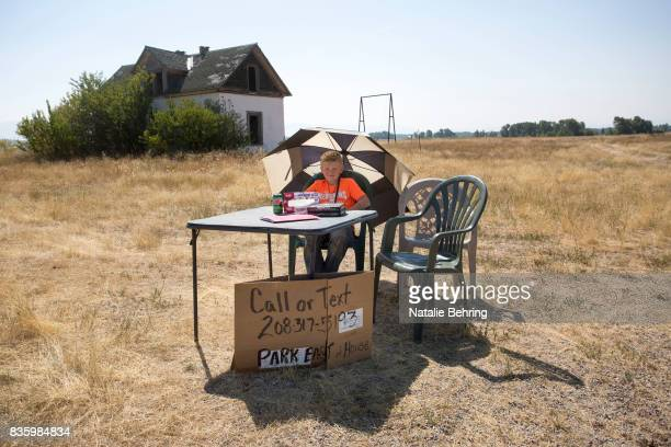 Ryker Fullmer waits for eclipse watchers to rent camping spots on his family's land on August 20 2017 in Tetonia Idaho Fuller said although there...