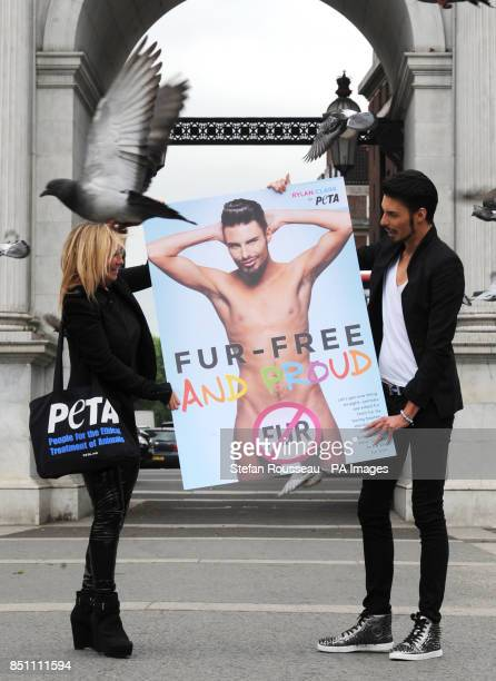 Rylan Clark unveils animal welfare group PETA's latest antifur campaign poster in London's Marble Arch today helped by Meg Mathews