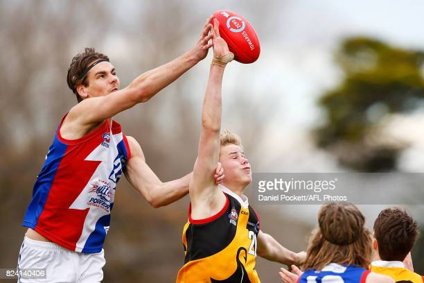 Rylan Henkel of the Power and Tom De Koning of the Stingrays contest the ball during the round 14 TAC Cup match between Dandenong and Gippsland at...