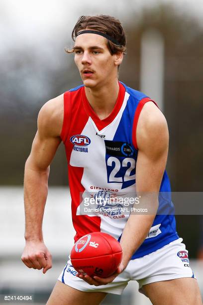 Rylan Henkel of the Power handpasses the ball during the round 14 TAC Cup match between Dandenong and Gippsland at Frankston Oval on July 29 2017 in...