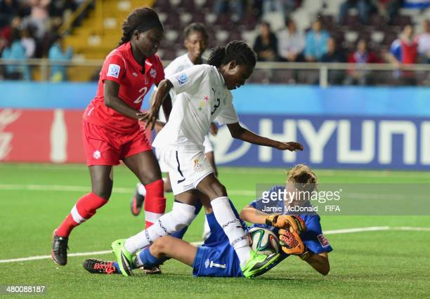 Rylee Foster of Canada saves at the feet of Jane Ayieyam of Ghana during the FIFA U17 Women's World Cup Group B match between Canada and Ghana at...
