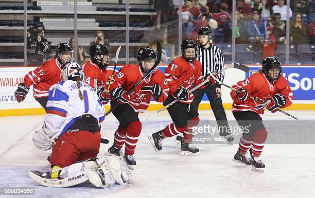 Ryleigh Houston of Team Canada celebrates a goal with teammates in a semifinal game against Team Russia during the 2016 IIHF U18 Women's World...