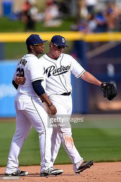 Rymer Liriano and Hunter Renfroe of the San Diego Padres walk off the field after the final out in the game against the Texas Rangers at the Peoria...