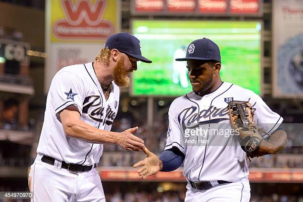 Rymer Liriano is congratulated by Andrew Cashner of the San Diego Padres after making a catch on a ball hit by Dee Gordon of the Los Angeles Dodgers...