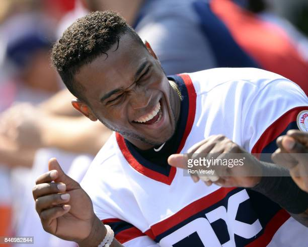 Rymer Liriano of the Chicago White Sox looks on while laughing in the dugout during the game against the San Francisco Giants on September 10 2017 at...