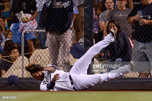 Rymer Liriano of the San Diego Padres hits the wall as he makes the catch on a ball hit by Dee Gordon of the Los Angeles Dodgers during the game at...