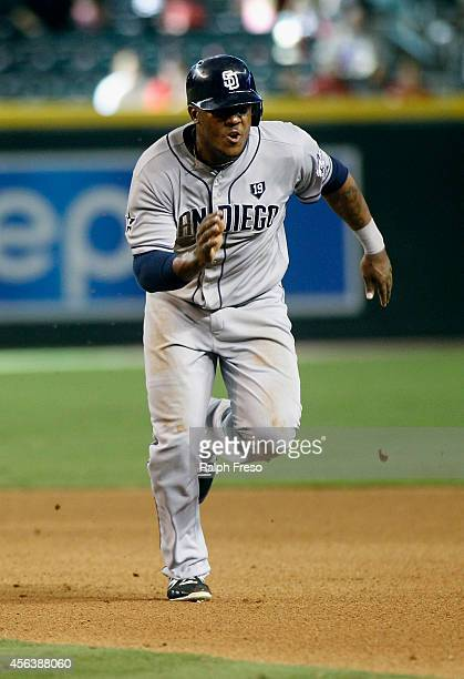 Rymer Liriano of the San Diego Padres hustles back to first base to avoid being doubled up on a deep fly ball during the seventh inning of a MLB game...