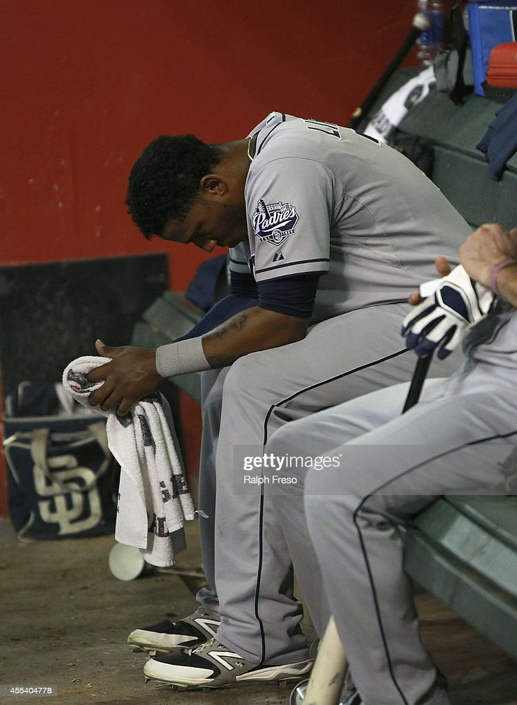 Rymer Liriano #7 of the San Diego Padres reacts in the dugout after striking out against the Arizona Diamondbacks during the sixth inning of a MLB game at Chase Field on September 13, 2014 in Phoenix, Arizona. The Diamondbacks defeated the Padres 10-4.