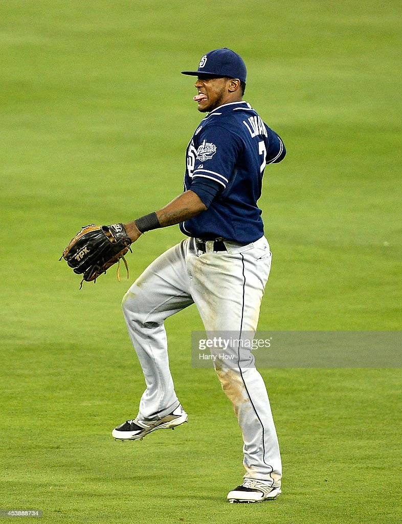 Rymer Liriano #7 of the San Diego Padres reacts to his catch for an out of Yasiel Puig #66 of the Los Angeles Dodgers during the seventh inning at Dodger Stadium on August 20, 2014 in Los Angeles, California.