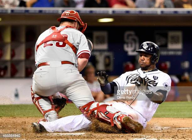 Rymer Liriano of the San Diego Padres scores ahead of the tag of Cameron Rupp of the Philadelphia Phillies during the sixth inning of a baseball game...