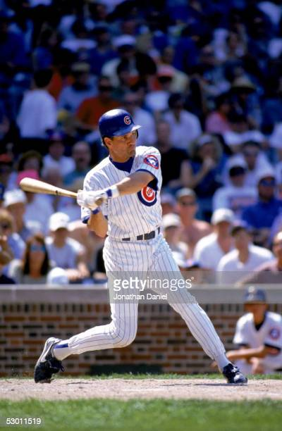 Ryne Sandberg of the Chicago Cubs bats during the game against the Cincinnati Reds at Wrigley Field on July 5 1996 in Chicago Illinois The Reds...