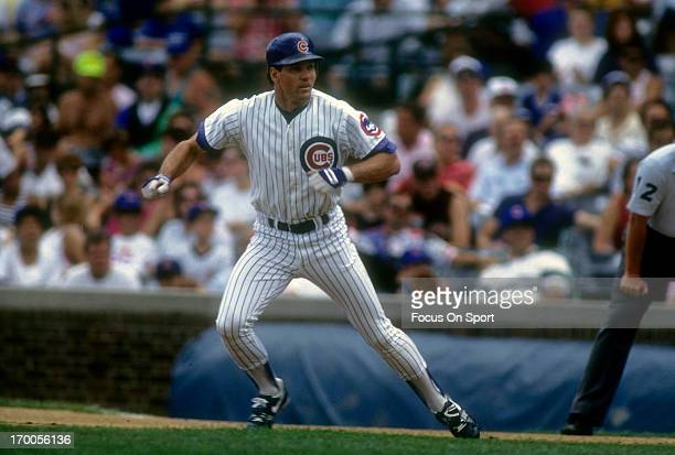 Ryne Sandberg of the Chicago Cubs leads off from first base during a MLB baseball game circa 1992 at Wrigley Field in Chicago Illinois Sandberg...
