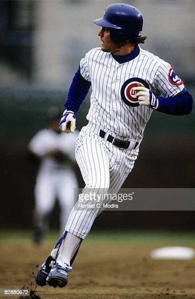 Ryne Sandberg of the Chicago Cubs runs to third base during a MLB game against the Pittsburgh Pirates in Wrigley Field on April 12 1991 in Chicago...