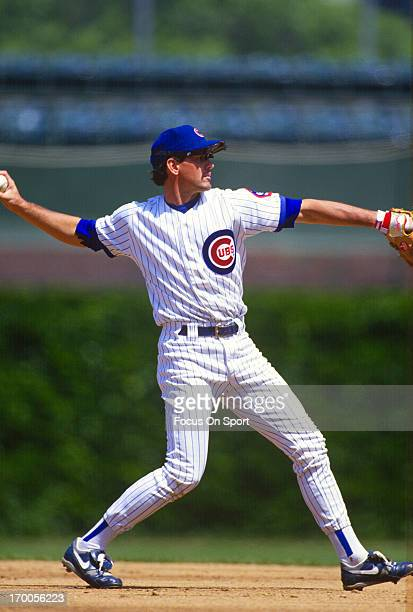 Ryne Sandberg of the Chicago Cubs throws the ball over to first base during an Major League Baseball game circa 1993 at Wrigley Field in Chicago...