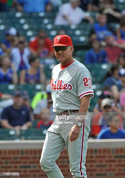 Ryne Sandberg of the Philadelphia Phillies manages against the Chicago Cubs on August 31 2013 at Wrigley Field in Chicago Illinois