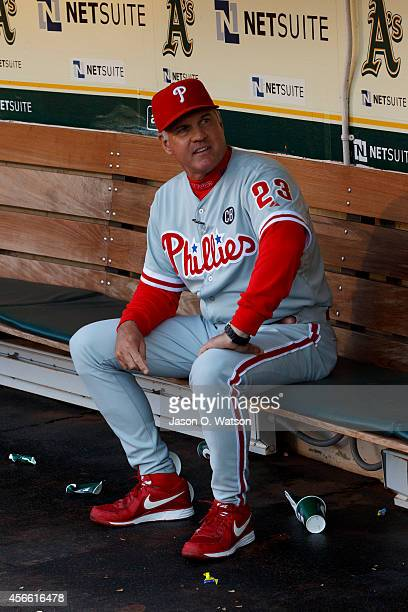 Ryne Sandberg of the Philadelphia Phillies sits in the dugout before an interleague game against the Oakland Athletics at Oco Coliseum on September...