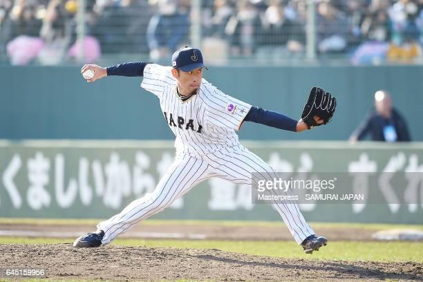 Ryo Akiyoshi of Samurai Japan pitches in the ninth inning during the SAMURAI JAPAN Friendly Opening Match between SAMURAI JAPAN and Fukuoka SoftBank...