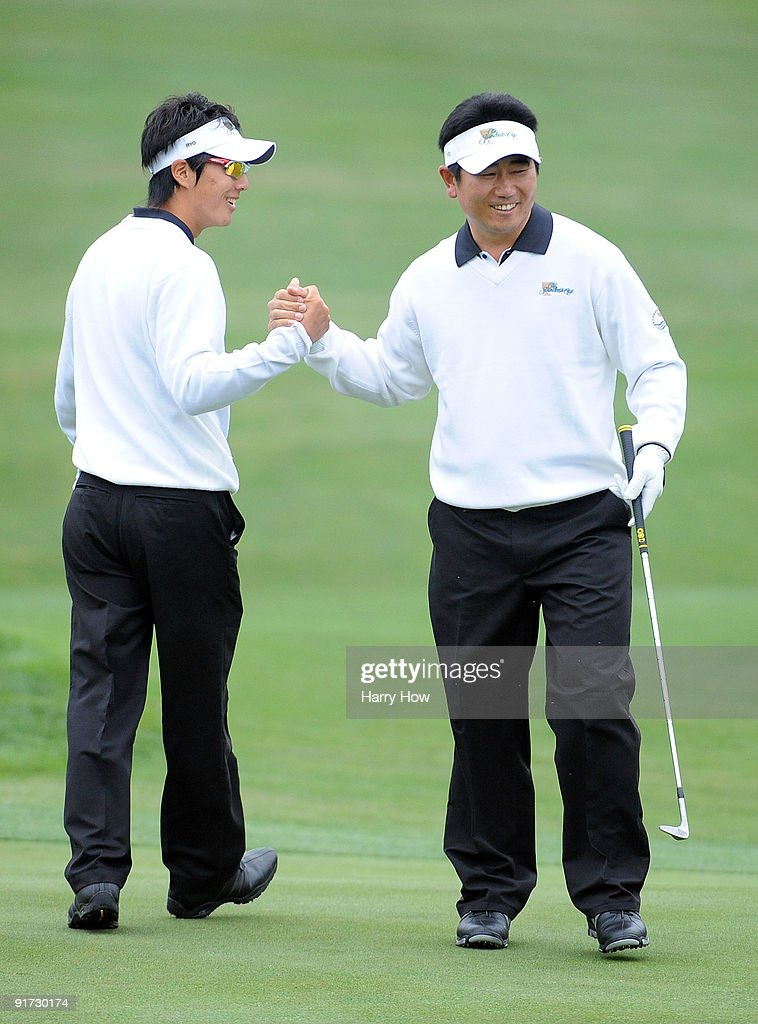 Ryo Ishikawa and YE Yang of the International Team celebrate a birdie on the first hole during the Day Three Morning Foursome Matches of The...