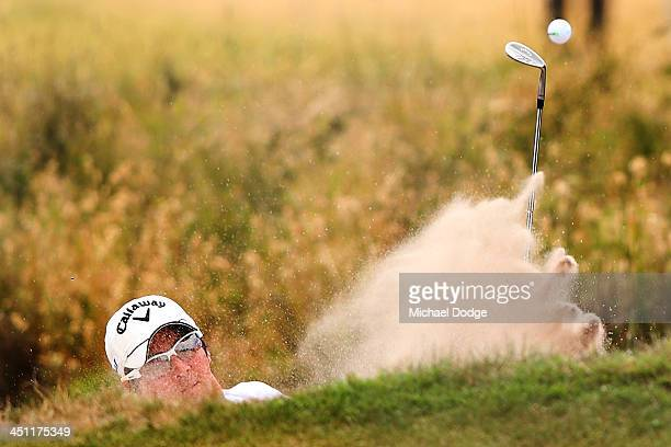 Ryo Ishikawa of Japan chips out of the bunker during day two of the World Cup of Golf at Royal Melbourne Golf Course on November 22 2013 in Melbourne...