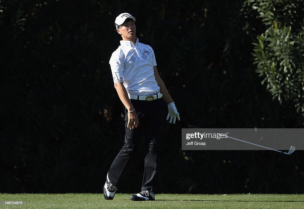 Ryo Ishikawa of Japan drops his club after hitting an errant tee shot on the 15th hole during the second round of the Humana Challenge In Partnership With The Clinton Foundation at La Quinta Country Club on January 18, 2013 in La Quinta, California.