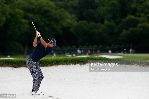 Ryo Ishikawa of Japan hits a shot from the sand on the 1st hole during the first round of the Crowne Plaza Invitational at the Colonial Country Club...