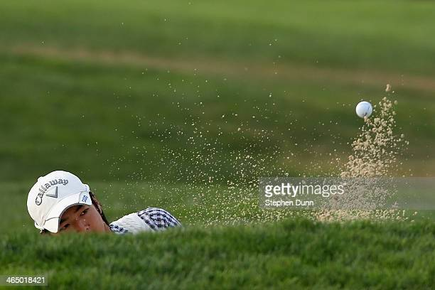 Ryo Ishikawa of Japan hits a shot out of a bunker on the 4th hole during the third round of the Farmers Insurance Open on Torrey Pines South on...