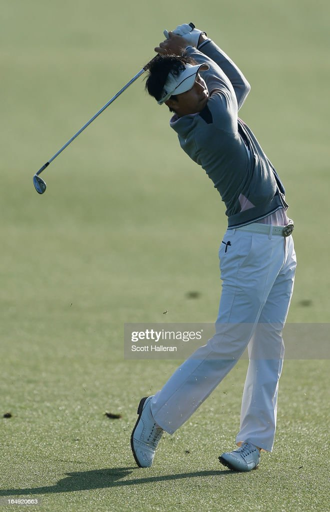 <a gi-track='captionPersonalityLinkClicked' href=/galleries/search?phrase=Ryo+Ishikawa&family=editorial&specificpeople=4297023 ng-click='$event.stopPropagation()'>Ryo Ishikawa</a> of Japan hits his approach shot on the third hole during the second round of the Shell Houston Open at the Redstone Golf Club on March 29, 2013 in Humble, Texas.