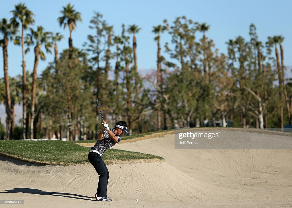 Ryo Ishikawa of Japan plays a bunker shot on the first hole during the first round of the Humana Challenge In Partnership With The Clinton Foundationat at the Palmer Private Course at PGA West on January 17, 2013 in La Quinta, California.