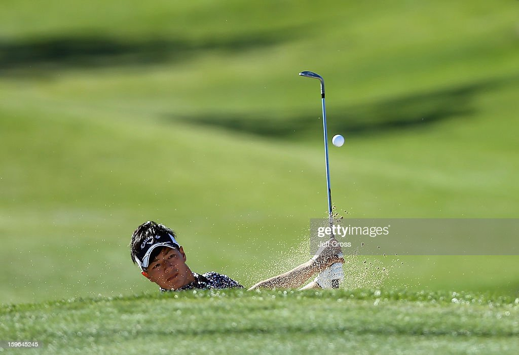 Ryo Ishikawa of Japan plays a bunker shot to the second green during the first round of the Humana Challenge In Partnership With The Clinton Foundationat at the Palmer Private Course at PGA West on January 17, 2013 in La Quinta, California.