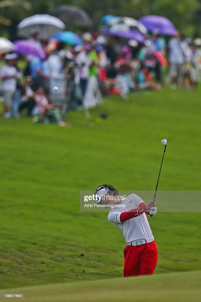 <a gi-track='captionPersonalityLinkClicked' href=/galleries/search?phrase=Ryo+Ishikawa&family=editorial&specificpeople=4297023 ng-click='$event.stopPropagation()'>Ryo Ishikawa</a> of Japan plays a shot during round four of the Thailand Golf Championship at Amata Spring Country Club on December 9, 2012 in Bangkok, Thailand.