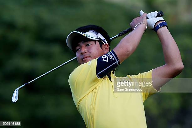 Ryo Ishikawa of Japan plays his shot from the 13th tee during the second round of the Sony Open In Hawaii at Waialae Country Club on January 15 2016...