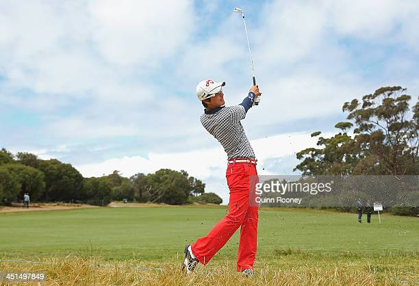 Ryo Ishikawa of Japan plays out of the rough during day three of the World Cup of Golf at Royal Melbourne Golf Course on November 23 2013 in...
