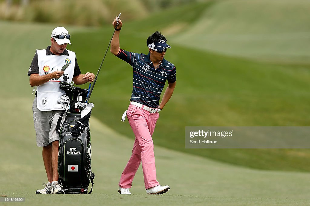 Ryo Ishikawa of Japan pulls a club during the first round of the Shell Houston Open at the Redstone Golf Club on March 28, 2013 in Humble, Texas.