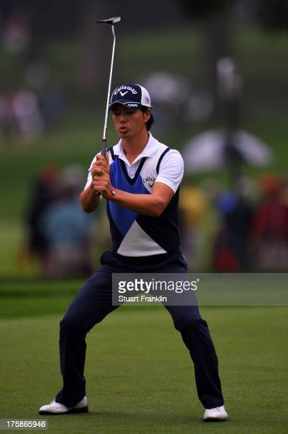 Ryo Ishikawa of Japan reacts on the 13th green during the second round of the 95th PGA Championship on August 9 2013 in Rochester New York