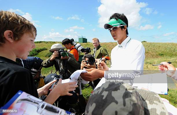 Ryo Ishikawa of Japan signs autographs during the practice round of the 138th Open Championship on July 13 2009 on the Ailsa Course Turnberry Golf...