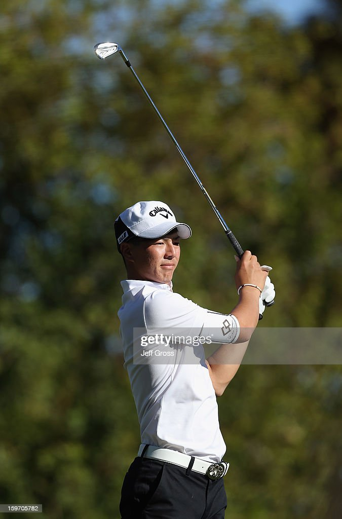 Ryo Ishikawa of Japan watches his tee shot on the seventh hole during the second round of the Humana Challenge In Partnership With The Clinton Foundation at La Quinta Country Club on January 18, 2013 in La Quinta, California.