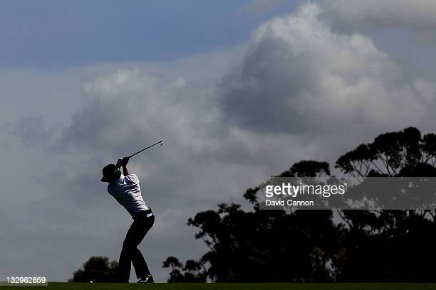Ryo Ishikawa of the International Team hits a shot during a practice round prior to the start of the 2011 Presidents Cup at Royal Melbourne Golf...
