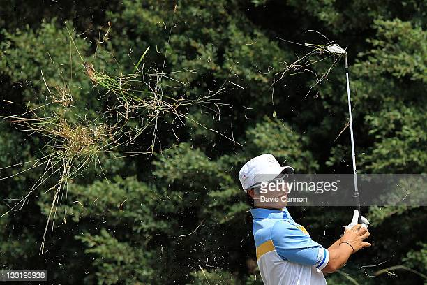 Ryo Ishikawa of the International Team hits his second shot on the eighth hole during the Day Two FourBall Matches of the 2011 Presidents Cup at...