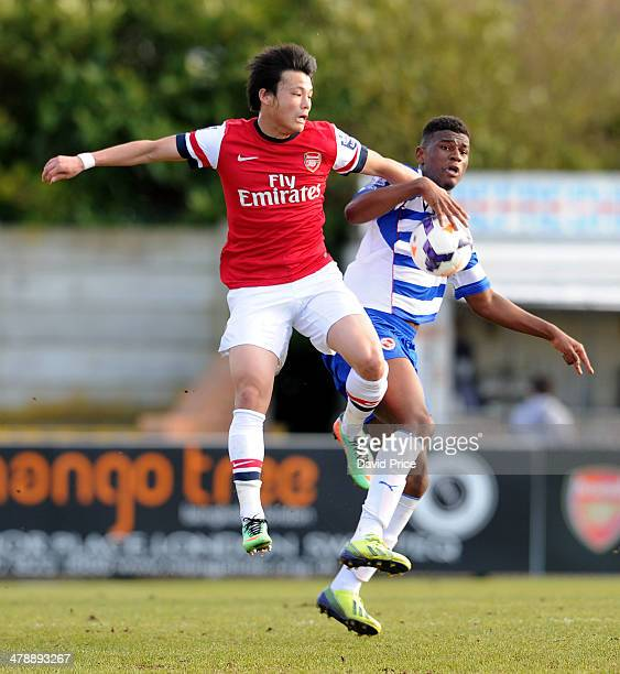Ryo Miyaichi of Arsenal challenges Aaron Tshibola of Reading during the match between Arsenal U21 and Reading U21 in the U21 League Cup Semi Final on...