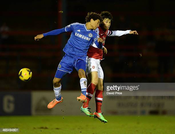 Ryo Miyaichi of Arsenal challenges Nathan Ake of Chelsea during the Under21 Premier League Cup match between Chelsea U21 and Arsenal U21 on January...