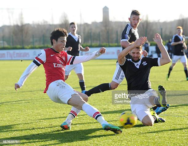 Ryo Miyaichi of Arsenal has his cross blocked by Jordan Turnbull of Southampton during the match between Arsenal U21 and Southampton U21 in the...