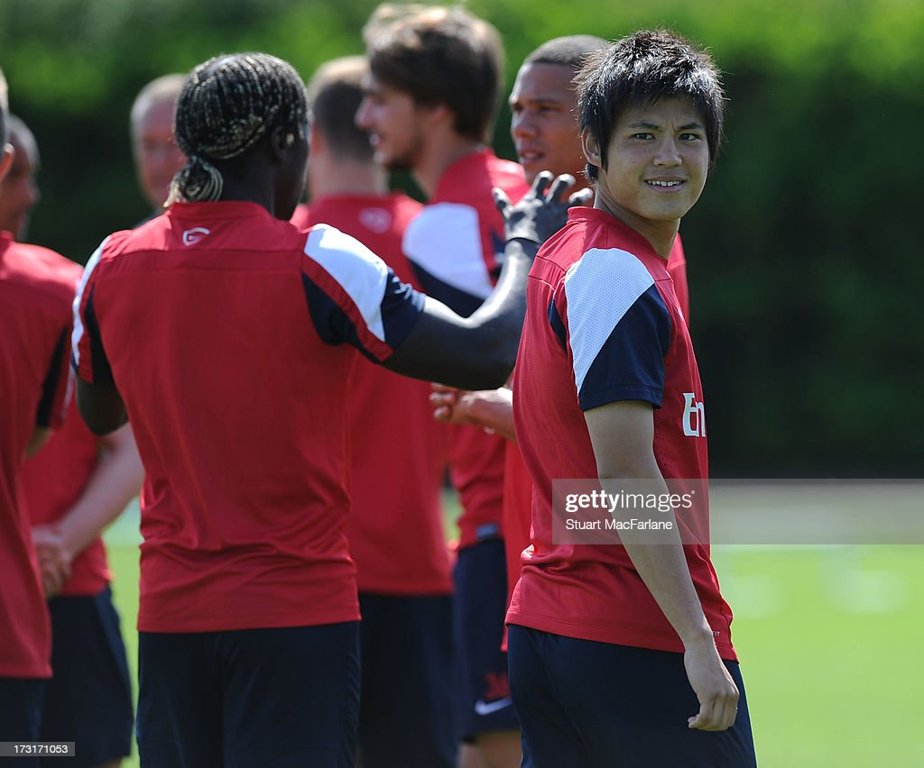 Ryo Miyaichi of Arsenal looks on during a training session at London Colney on July 09, 2013 in St Albans, England.