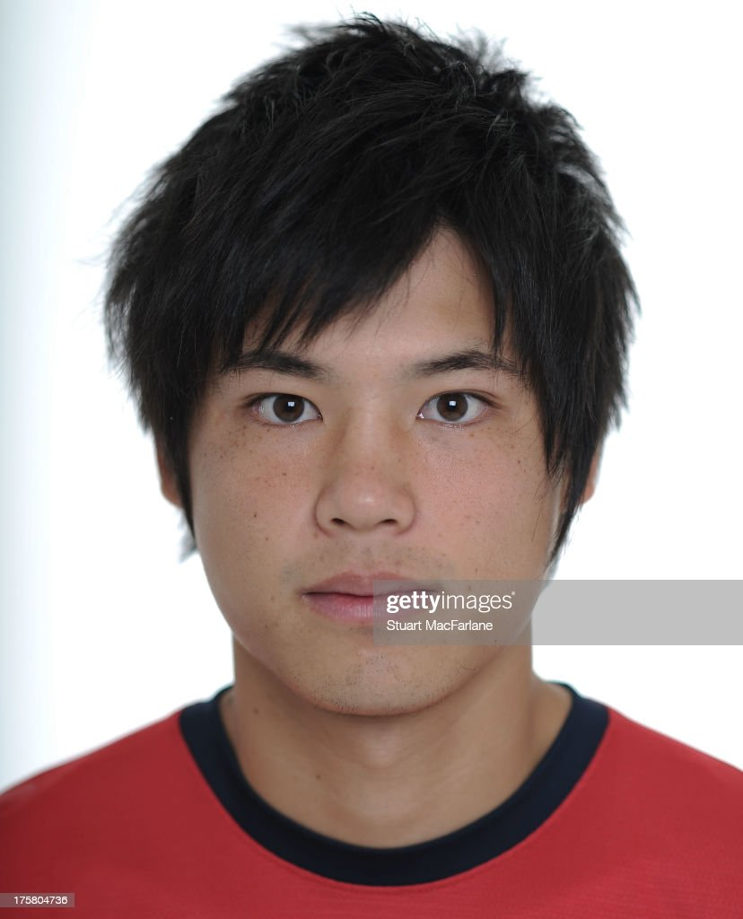 <a gi-track='captionPersonalityLinkClicked' href=/galleries/search?phrase=Ryo+Miyaichi&family=editorial&specificpeople=6444719 ng-click='$event.stopPropagation()'>Ryo Miyaichi</a> of Arsenal poses during the first team photocall at Emirates Stadium on August 08, 2013 in London, England.