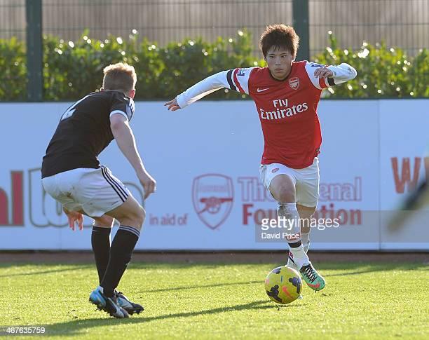 Ryo Miyaichi of Arsenal runs at Jason McCarthy of Southampton during the match between Arsenal U21 and Southampton U21 in the Barclays U21 League at...