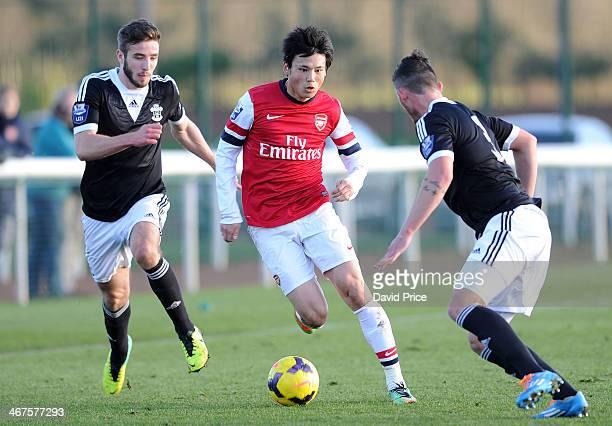 Ryo Miyaichi of Arsenal runs at Sam McQueen and Matt Young of Southampton during the match between Arsenal U21 and Southampton U21 in the Barclays...