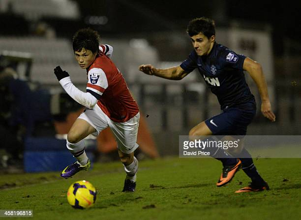Ryo Miyaichi of Arsenal takes on James Reece of Man Utd during the match between Arsenal U21 and Manchester United U21 at Meadow Park on December 20...