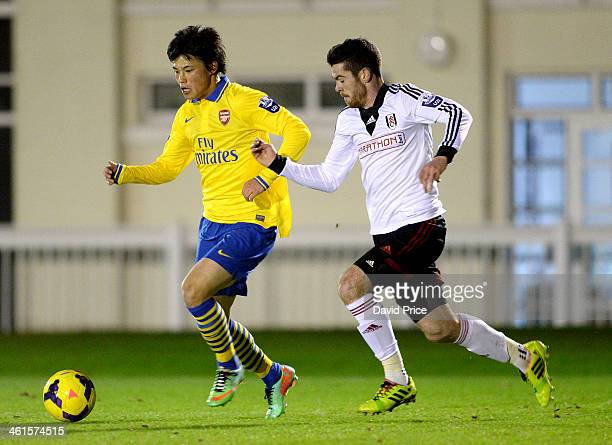 Ryo Miyaichi of Arsenal takes on Liam Donnelly of Fulham during the U21 League Cup match between Fulham and Arsenal on January 9 2014 in London...
