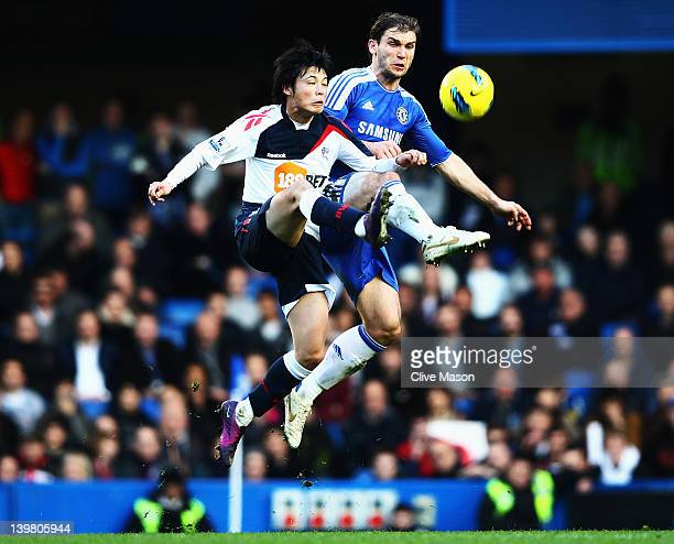 Ryo Miyaichi of Bolton Wanderers and Branislav Ivanovic of Chelsea in action during the Barclays Premier League match between Chelsea and Bolton...